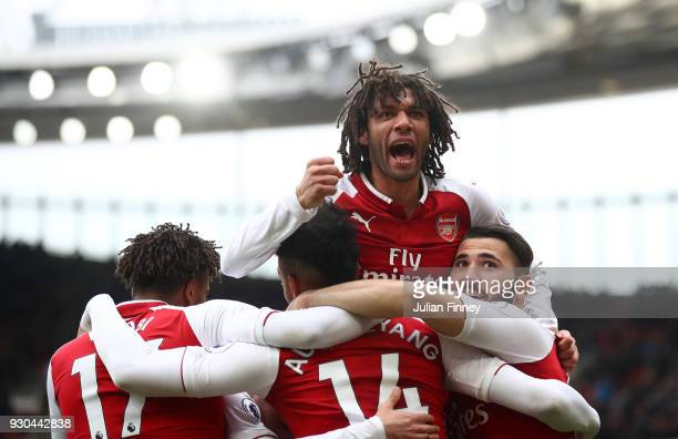 PierreEmerick Aubameyang of Arsenal celebrates scoring the 2nd Arsenal goal with Mohamed Elneny of Arsenal during the Premier League match between...