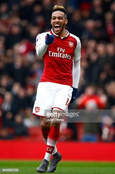 PierreEmerick Aubameyang of Arsenal celebrates scoring the first goal during the Premier League match between Arsenal and Southampton at Emirates...