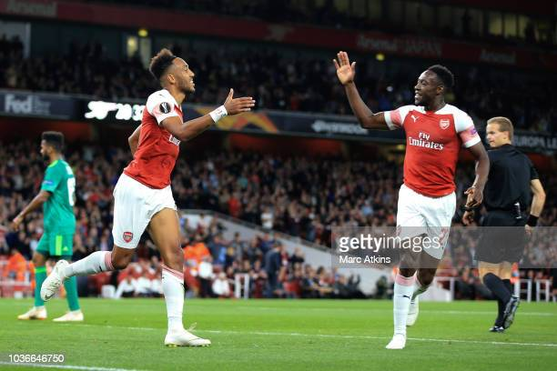 PierreEmerick Aubameyang of Arsenal celebrates scoring the opening goal with c during the UEFA Europa League Group E match between Arsenal and...
