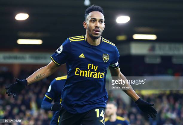 PierreEmerick Aubameyang of Arsenal celebrates scoring the re taken penalty during the Premier League match between Norwich City and Arsenal FC at...