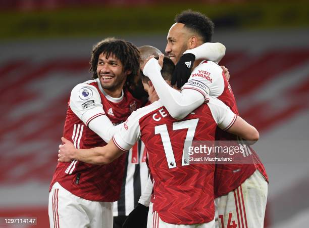 Pierre-Emerick Aubameyang of Arsenal celebrates scoring the third goal with Mo Elneny and Cedric during the Premier League match between Arsenal and...