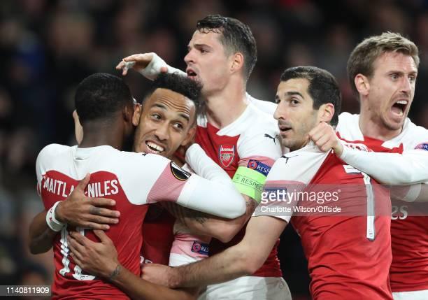 PierreEmerick Aubameyang of Arsenal celebrates scoring their 3rd goal with Ainsley MaitlandNiles Granit Xhaka Henrikh Mkhitaryan and Nacho Monreal...