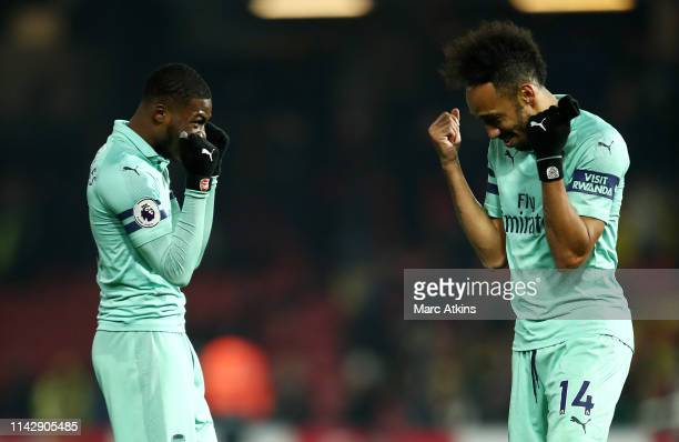 PierreEmerick Aubameyang of Arsenal celebrates with Ainsley MaitlandNiles of Arsenal at the final whistle during the Premier League match between...