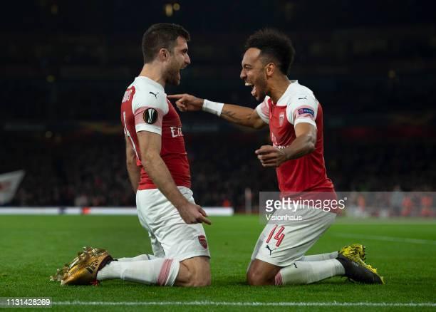 PierreEmerick Aubameyang of Arsenal celebrates with goalscorer Sokratis Papastathopoulos during the UEFA Europa League Round of 32 Second Leg match...