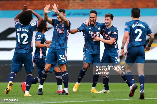 PierreEmerick Aubameyang of Arsenal celebrates with his team mates after scoring his team's third goal during the Premier League match between Fulham...