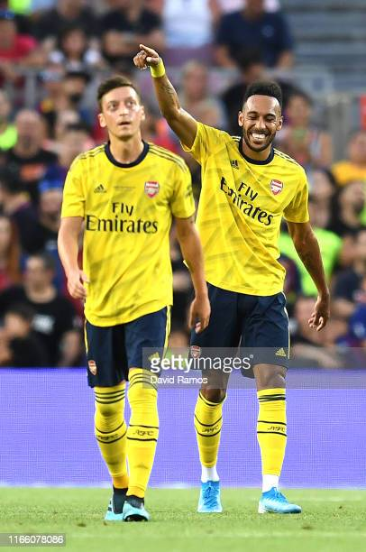 Pierre-Emerick Aubameyang of Arsenal celebrates with his tem mate Mesut Ozil after scoring his team's first goal during the Joan Gamper trophy...