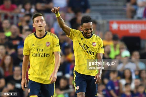 PierreEmerick Aubameyang of Arsenal celebrates with his tem mate Mesut Ozil after scoring his team's first goal during the Joan Gamper trophy...