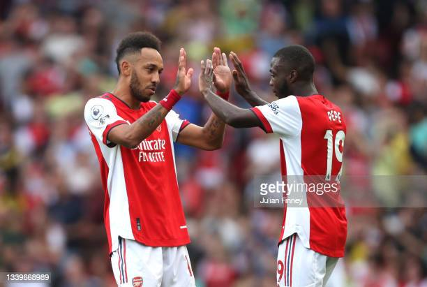 Pierre-Emerick Aubameyang of Arsenal celebrates with Nicolas Pepe after scoring their side's first goal during the Premier League match between...