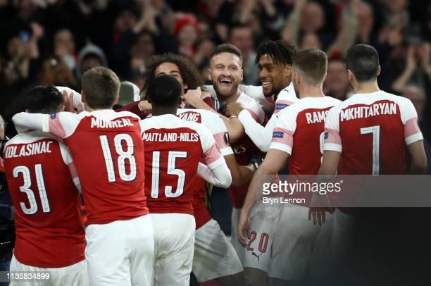 PierreEmerick Aubameyang of Arsenal celebrates with Shkodran Mustafi and teammates after scoring his team's third goal during the UEFA Europa League...