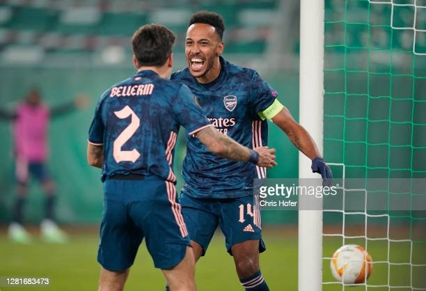 PierreEmerick Aubameyang of Arsenal celebrates with team mate Hector Bellerin after scoring his sides second goal during the UEFA Europa League Group...