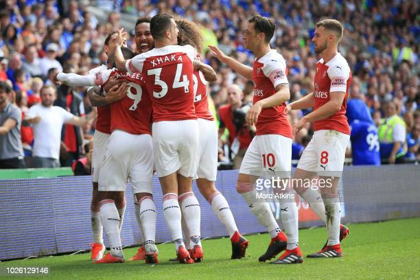 PierreEmerick Aubameyang of Arsenal celebrates with team mates after scoring the 2nd goal during the Premier League match between Cardiff City and...