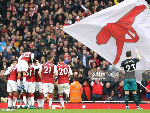 PierreEmerick Aubameyang of Arsenal celebrates with team mates after scoring his sides first goal during the Premier League match between Arsenal and...