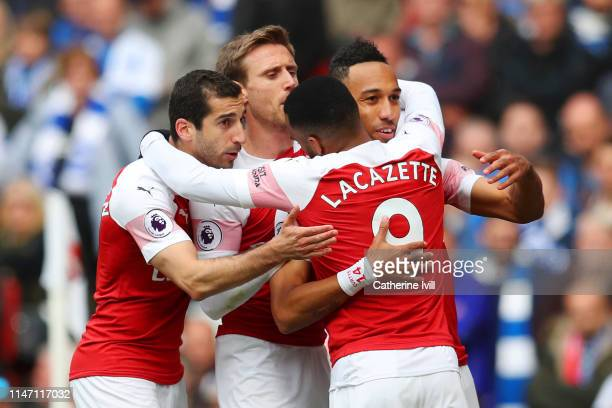 PierreEmerick Aubameyang of Arsenal celebrates with team mates as he scores his team's first goal from a penalty during the Premier League match...