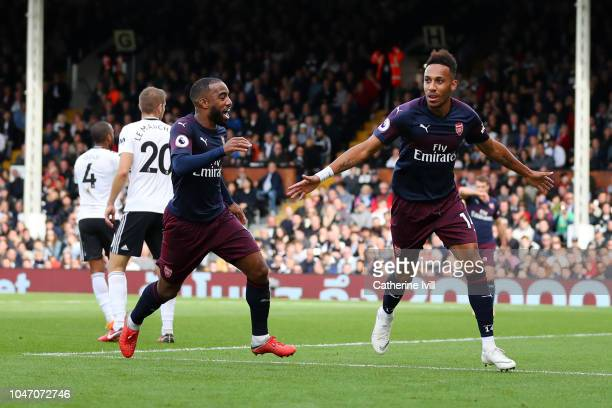 PierreEmerick Aubameyang of Arsenal celebrates with teammate Alexandre Lacazette after scoring his team's fourth goal during the Premier League match...