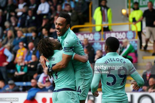 Pierre-Emerick Aubameyang of Arsenal celebrates with teammate Alex Iwobi after scoring his team's first goal during the Premier League match between...