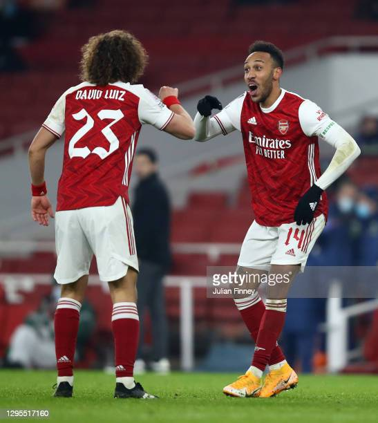Pierre-Emerick Aubameyang of Arsenal celebrates with teammate David Luiz after scoring their sides second goal during the FA Cup Third Round match...
