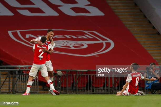 Pierre-Emerick Aubameyang of Arsenal celebrates with teammate Hector Bellerin after scoring his team's second goal during the FA Cup Semi Final match...