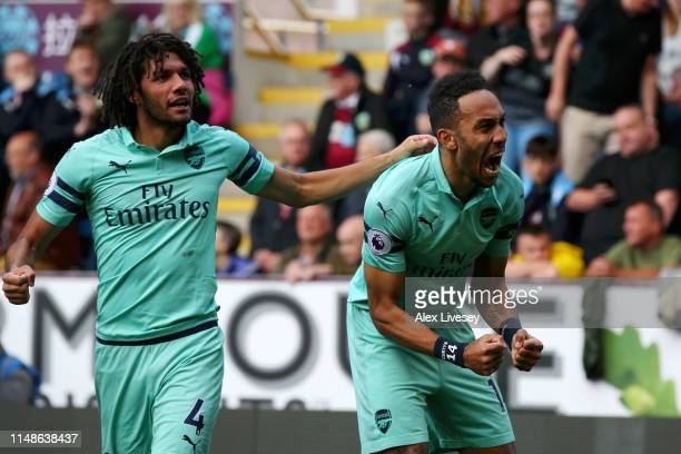 PierreEmerick Aubameyang of Arsenal celebrates with teammate Mohamed Elneny after scoring his team's first goal during the Premier League match...