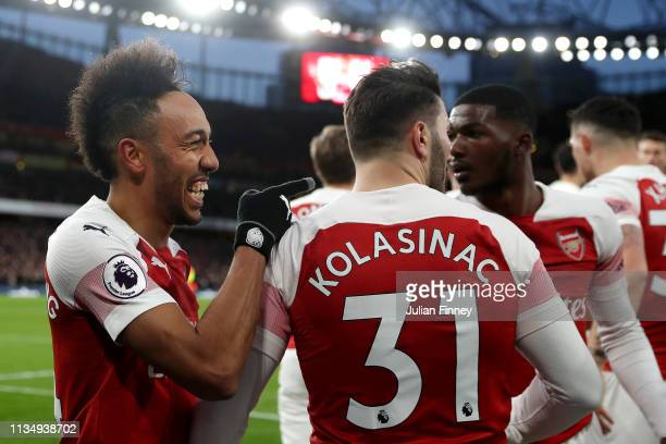 PierreEmerick Aubameyang of Arsenal celebrates with teammates after scoring his team's second goal during the Premier League match between Arsenal FC...