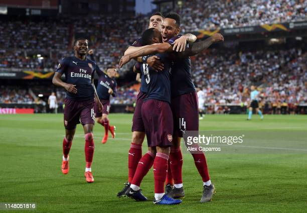PierreEmerick Aubameyang of Arsenal celebrates with teammates after scoring his team's first goal during the UEFA Europa League Semi Final Second Leg...