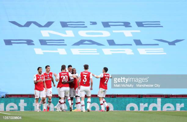 Pierre-Emerick Aubameyang of Arsenal celebrates with teammates after scoring his teams first goal during the FA Cup Semi Final match between Arsenal...