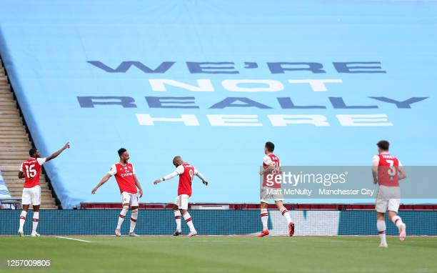 PierreEmerick Aubameyang of Arsenal celebrates with teammates after scoring his teams first goal during the FA Cup Semi Final match between Arsenal...