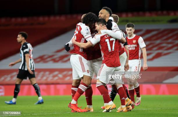 Pierre-Emerick Aubameyang of Arsenal celebrates with teammates Alexandre Lacazette, Mohamed Elneny and Cedric Soares after scoring their team's third...