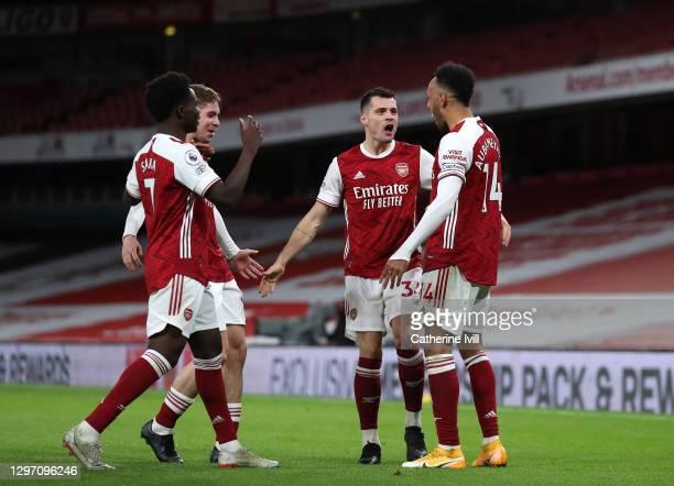 Pierre-Emerick Aubameyang of Arsenal celebrates with teammates Bukayo Saka, Emile Smith Rowe and Granit Xhaka after scoring their team's first goal...