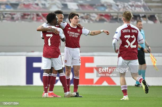 Pierre-Emerick Aubameyang of Arsenal celebrates with teammates Bukayo Saka, Hector Bellerin, and Emile Smith Rowe after scoring his team's first goal...