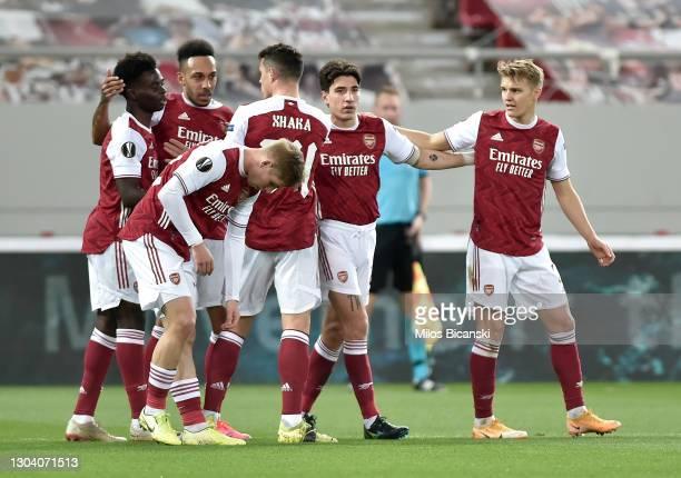 Pierre-Emerick Aubameyang of Arsenal celebrates with teammates Bukayo Saka, Emile Smith Rowe, Granit Xhaka, Hector Bellerin and Martin Odegaard after...