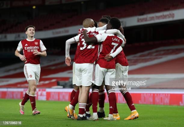 Pierre-Emerick Aubameyang of Arsenal celebrates with teammates Kieran Tierney, Alexandre Lacazette, Emile Smith Rowe and Bukayo Saka after scoring...