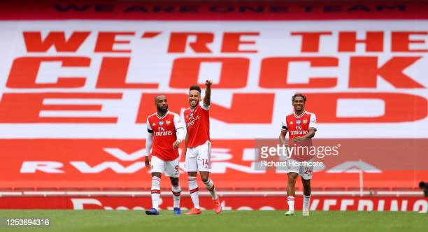 Pierre-Emerick Aubameyang of Arsenal celebrates with teammates Reiss Nelson and Alexandre Lacazette after scoring his team's first goal during the...
