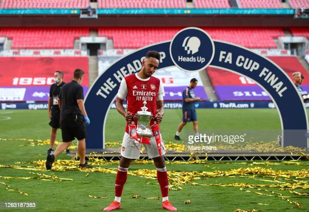 Pierre-Emerick Aubameyang of Arsenal celebrates with the Heads Up Emirates FA Cup Trophy following his team's victory in the FA Cup Final match...
