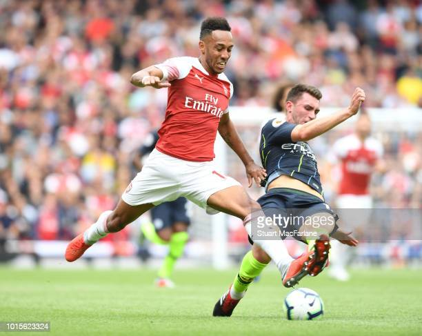 PierreEmerick Aubameyang of Arsenal challenged by Aymeric Laporte of Man City during the Premier League match between Arsenal FC and Manchester City...