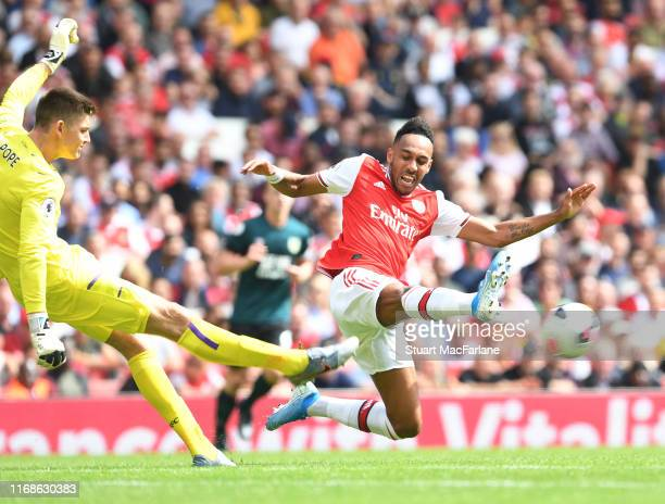 PierreEmerick Aubameyang of Arsenal challenges Burnley goalkeeper Nick Pope during the Premier League match between Arsenal FC and Burnley FC at...