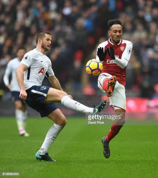 PierreEmerick Aubameyang of Arsenal challenges Eric Dier of Tottenham during the Premier League match between Tottenham Hotspur and Arsenal at...