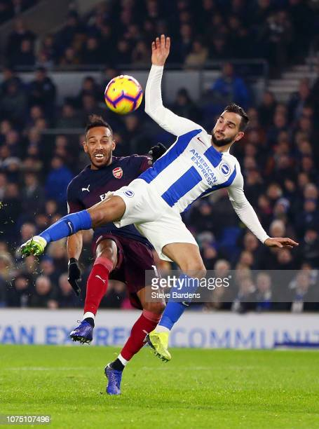 PierreEmerick Aubameyang of Arsenal challenges for the ball with Martin Montoya of Brighton Hove Albion during the Premier League match between...