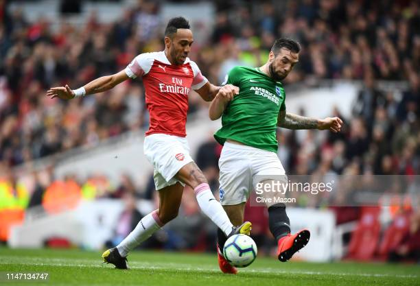 PierreEmerick Aubameyang of Arsenal challenges for the ball with Shane Duffy of Brighton and Hove Albion during the Premier League match between...