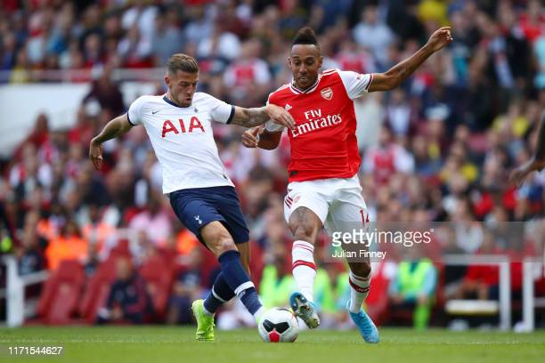 PierreEmerick Aubameyang of Arsenal challenges for the ball with Toby Alderweireld of Tottenham Hotspur during the Premier League match between...