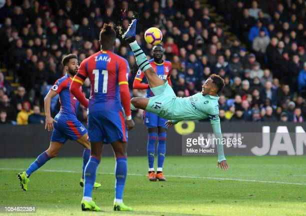 PierreEmerick Aubameyang of Arsenal clears the ball with a bicycle kick during the Premier League match between Crystal Palace and Arsenal FC at...
