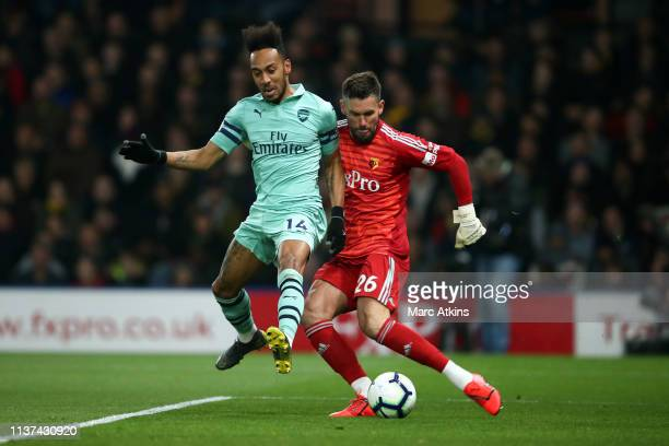 PierreEmerick Aubameyang of Arsenal closes down Ben Foster of Watford and scores the winning goal during the Premier League match between Watford FC...