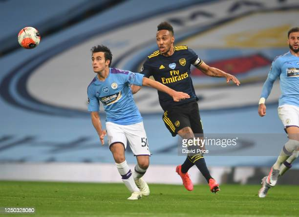PierreEmerick Aubameyang of Arsenal closes down Eric Garcia of Man City during the Premier League match between Manchester City and Arsenal FC at...