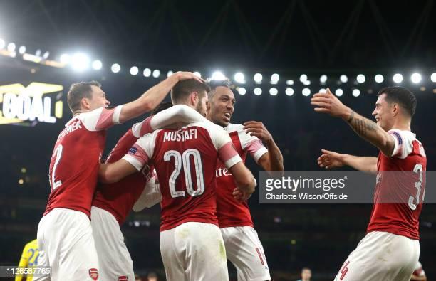 Pierre-Emerick Aubameyang of Arsenal congratulates Shkodran Mustafi of Arsenal as he celebrates scoring their 2nd goal during the UEFA Europa League...