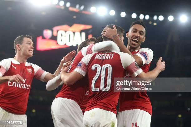 PierreEmerick Aubameyang of Arsenal congratulates Shkodran Mustafi of Arsenal as he celebrates scoring their 2nd goal during the UEFA Europa League...