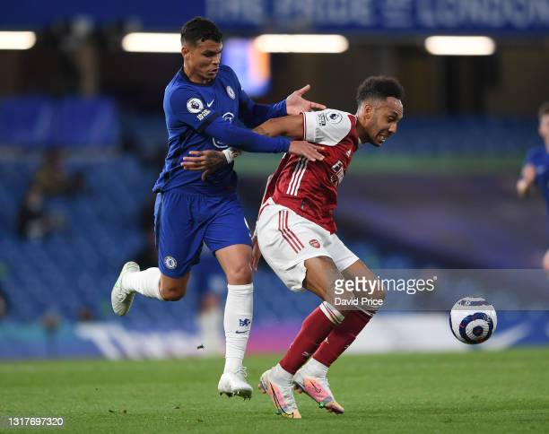 Pierre-Emerick Aubameyang of Arsenal controls the ball under pressure from Thiago Silva of Chelsea during the Premier League match between Chelsea...