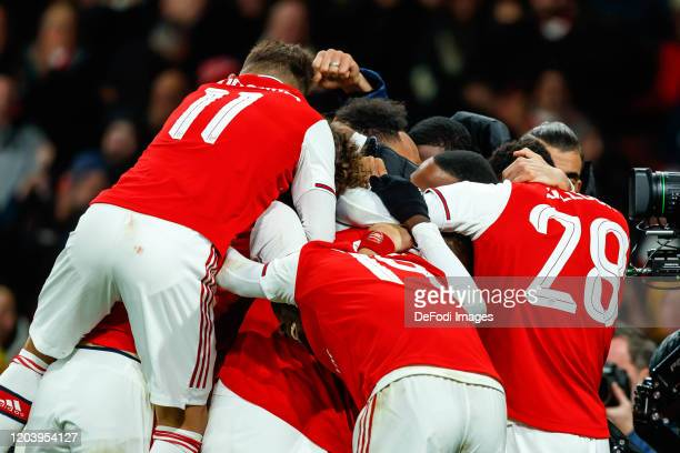 PierreEmerick Aubameyang of Arsenal FC celebrates after scoring his team's first goal with teammates during the UEFA Europa League round of 32 second...