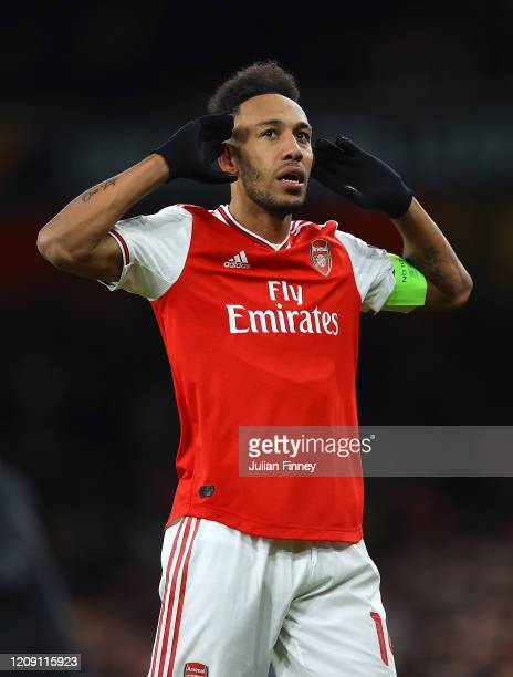 PierreEmerick Aubameyang of Arsenal FC celebrates after scoring his team's first goal in extratime during the UEFA Europa League round of 32 second...