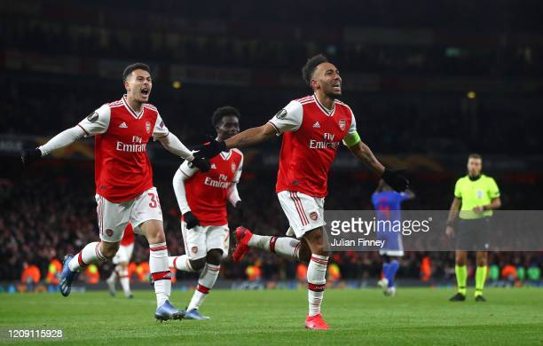 Pierre-Emerick Aubameyang of Arsenal FC celebrates after scoring his team's first goal in extra-time during the UEFA Europa League round of 32 second...