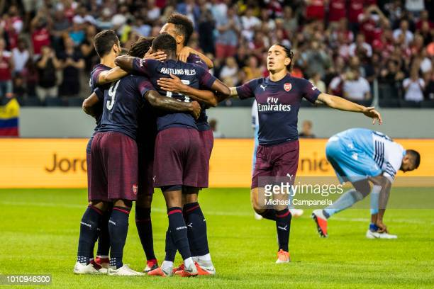 PierreEmerick Aubameyang of Arsenal FC celebrates the 20 goal with Mohamed Elneny and Ainsley MaitlandNiles during the Preseason friendly between...