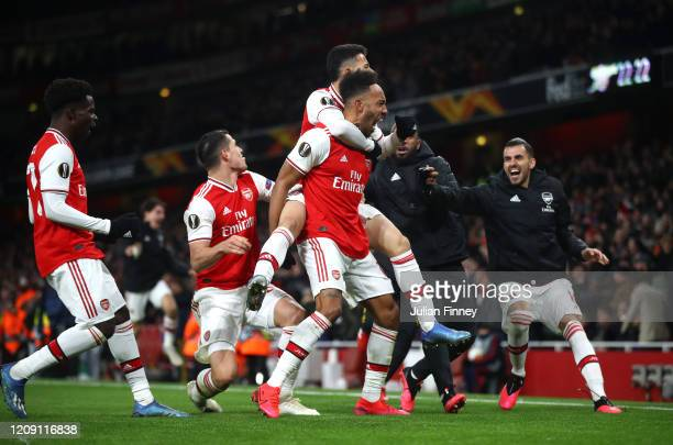 Pierre-Emerick Aubameyang of Arsenal FC celebrates with teammates after scoring his team's first goal in extra-time during the UEFA Europa League...